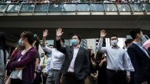 Thousands in Hong Kong defy Xi with pro-democracy rallies