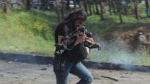 Syrian photographer puts down his camera to carry wounded children to safety