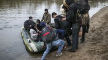 Turkey's borders with Europe open as migrants gather, says president