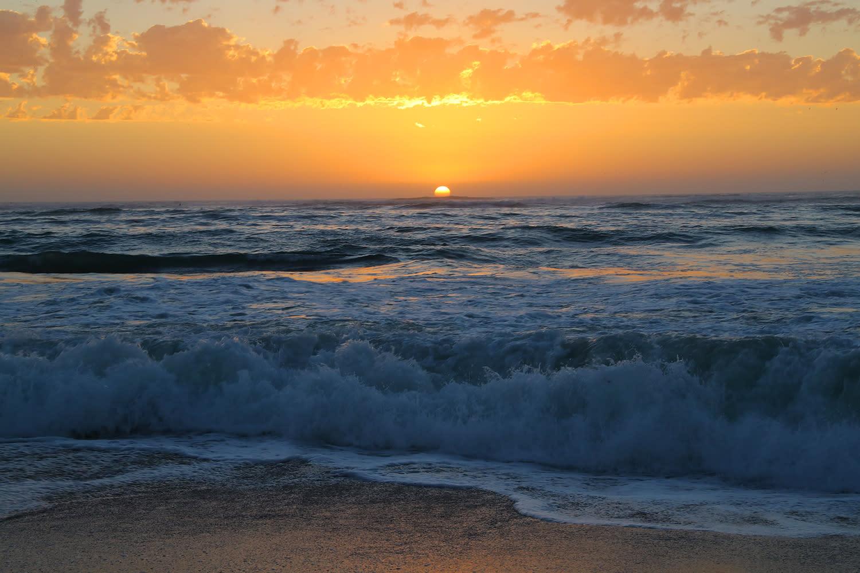 <p>The sun begins to set over the Atlantic Ocean on the shores of Swakopmund, Namibia. (Photo: Gordon Donovan/Yahoo News) </p>