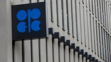 Oil rises nearly one percent as OPEC defers extension of output cuts