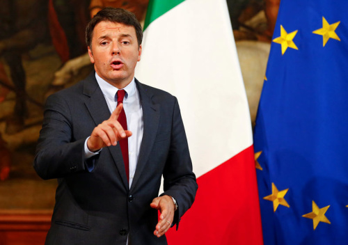 Italian PM Renzi gestures as he talks during a news conference at Chigi Palace in Rome