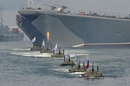Russian amphibious vehicles drive in formation during celebrations to mark Navy Day in the far eastern Russian port of Vladivostok July 27, 2014. REUTERS/Yuri Maltsev
