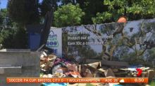 People dumping recycling at bottle return stations