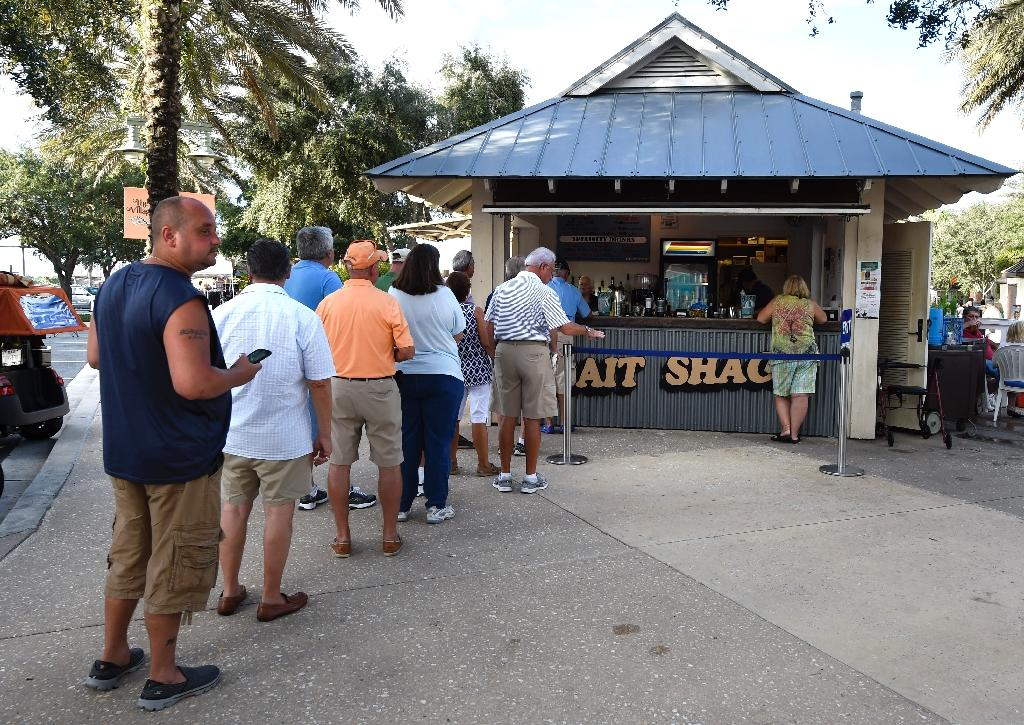 Residents line up for happy hour at the Bait Shack Bar in The Villages retirement community, an important Republican stronghold for Donald Trump in Florida (AFP Photo/Rhona Wise)