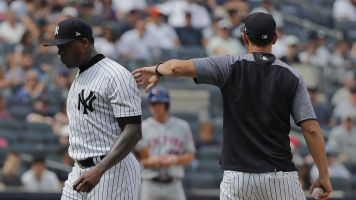 Yankees fans boo Aroldis Champman off the mound after he throws 16 balls in 19 pitches