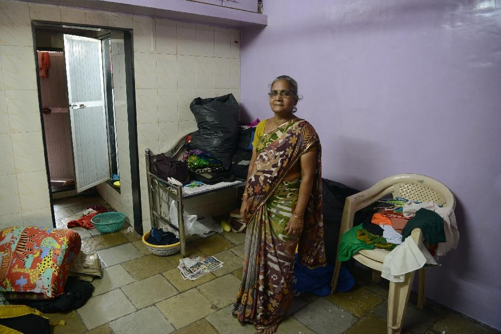 Surekha Chiplunkar, 60, stands in her house that has recently flooded, during an interview with AFP in Mumbai (AFP Photo/PUNIT PARANJPE)