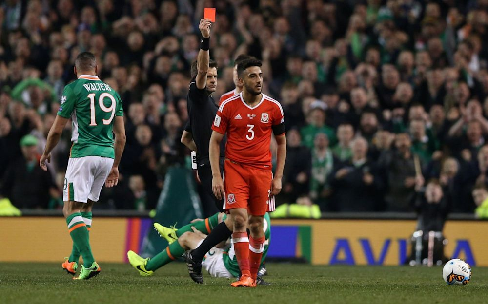 Neil Taylor is shown his marching orders   - PA