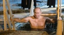 Putin takes icy plunge as Orthodox believers mark Epiphany