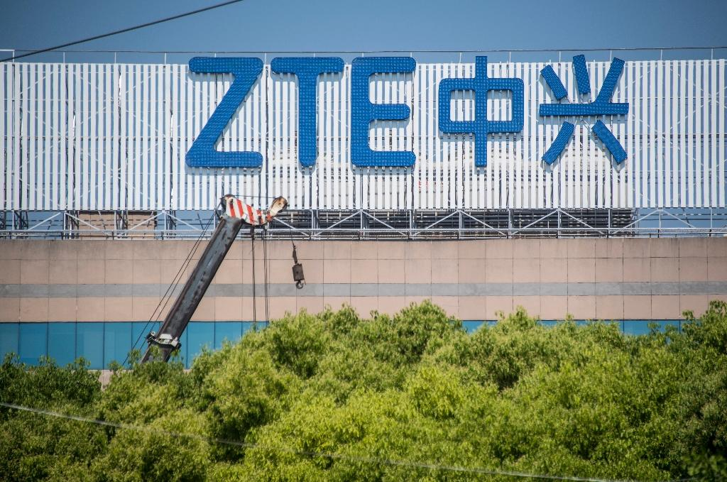 ZTE, found guilty of violating sanctions by selling US goods to Iran and North Korea, had been slapped with Commerce Department penalties that barred US firms from doing business with the smartphone-making giant (AFP Photo/Johannes EISELE)