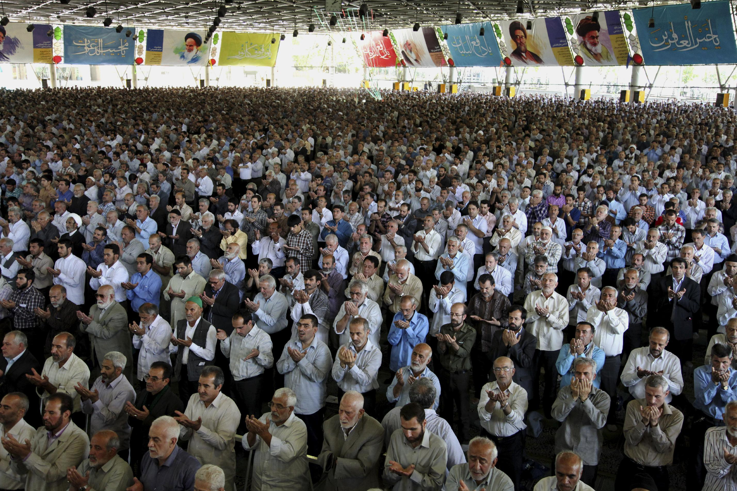 Iranian worshippers perform their Friday prayers at the Tehran University campus in Tehran, Iran, Friday, June 7, 2013. Iranian Presidential election will be held on June 14, 2013. (AP Photo/Ebrahim Noroozi)