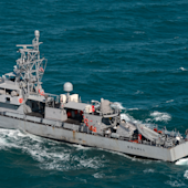 US Navy ship fires warning shots after multiple ships 'harassed' by Iranian attack craft