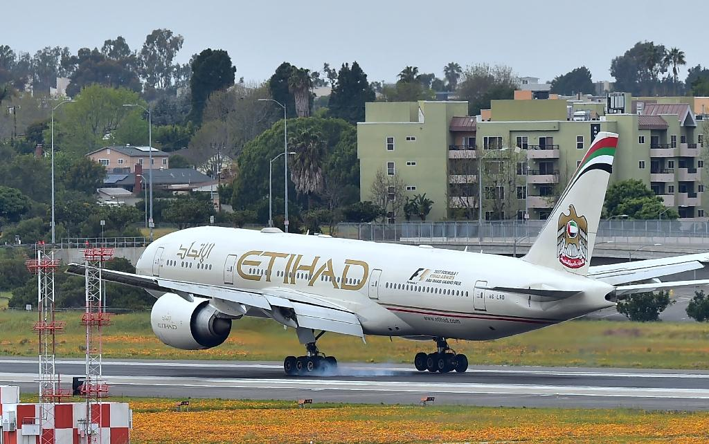 Abu Dhabi's Etihad Airways says it will suspend flights to Qatar after the United Arab Emirates was among major Gulf states to sever ties with Doha in an unprecedented regional crisis