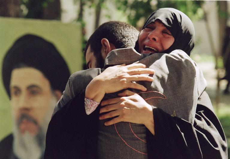 Hundreds of thousands were killed on both sides in eight years of war between Iran and Iraq, with this August 1, 1989, photograph showing an Iranian mother hugging her son after his release from a prisoner of war camp