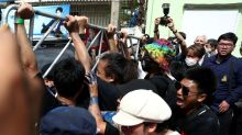 Thai activists scuffle with police officers