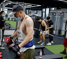 Gyms are starting to reopen — here's a look at what it's like to work out during the pandemic