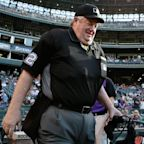 Ump Joe West wins $500K from ex-player in defamation suit