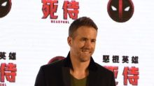 Ryan Reynolds dishes on the Deadpool suit and Chris Evans' 'powerful ass'