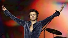 Liam Payne turns fan as he watches Harry Styles on stage at Jingle Bell Ball
