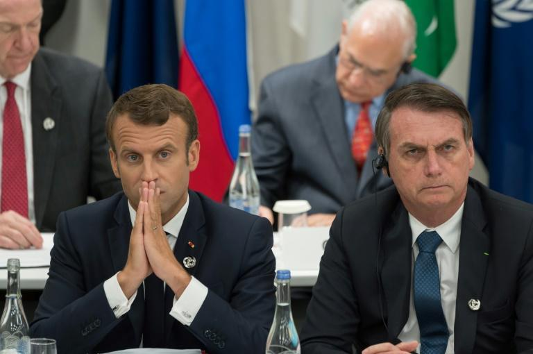 France's President Emmanuel Macron, pictured (L) with Jair Bolsonaro at the June 2019 G20 Summit in Osaka, accused the Brazilian leader of lying about his country's climate change stance (AFP Photo/Jacques Witt)