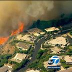 Evacuation orders lifted in Pacific Palisades after fire consumes 40 acres, threatens hillside homes