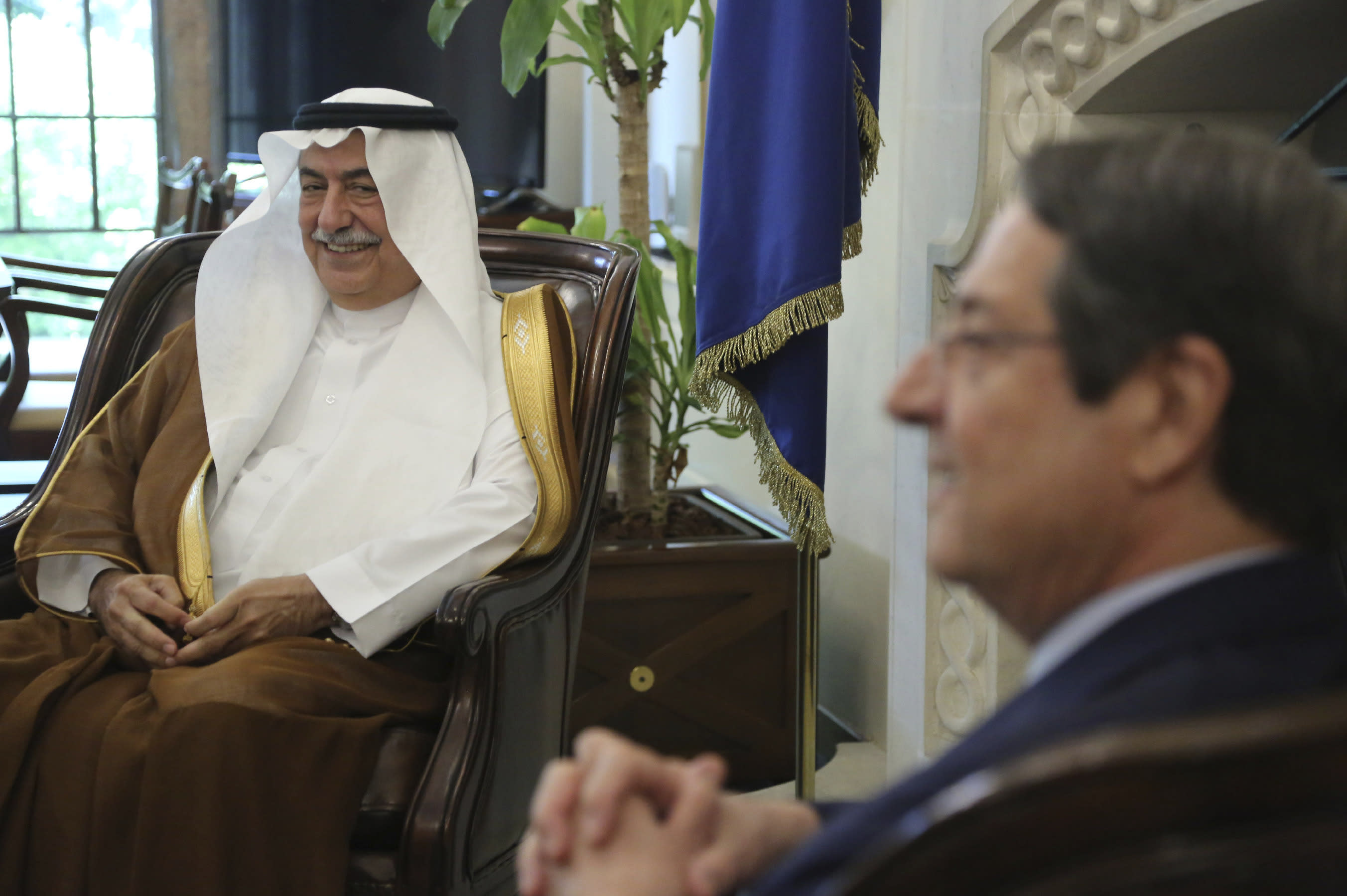 Cyprus' president Nicos Anastasiades, right, and Saudi Foreign Minister Ibrahim Bin Abdulaziz Al-Assaf talk during their meeting at the presidential palace in capital Nicosia, Cyprus, Wednesday Sept. 11, 2019. (AP Photo/Petros Karadjias)