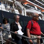 American Passenger's Coronavirus Diagnosis Raises New Fears