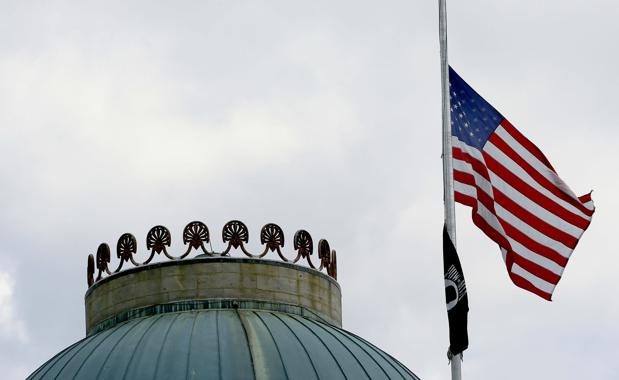 <p>The United States flag flies at half-staff over the State Capitol in Raleigh, N.C., Wednesday, July 12, 2017, following the death of six Marines and a Navy sailor from Camp Lejeune, who were among the 16 service members killed Monday when their plane crashed in a field in rural Mississippi. The plane was a KC-130T, a tanker from Marine Aerial Refueling and Transport Squadron 452, a Marine Forces Reserve unit based in Fort Stewart, N.Y. (Photo: Gerry Broome/AP) </p>