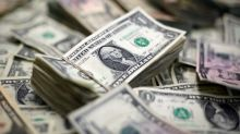 Dollar hits 2018 peak, supported by yields, retail sales data