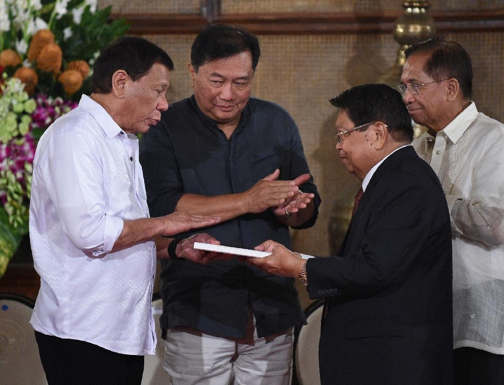 Duterte met with lawmakers late Monday, asking them to hold a special session on Saturday to discuss his request for an extension of military rule in the region (AFP Photo/TED ALJIBE)