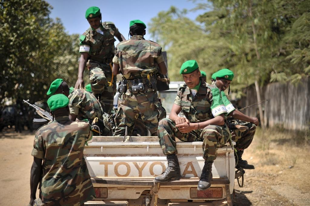 In this handout pictured released by the African Union-United Nations Information Support Team, Ethiopian soldiers ready themselves for departure after a ceremony in Baidoa, Somalia