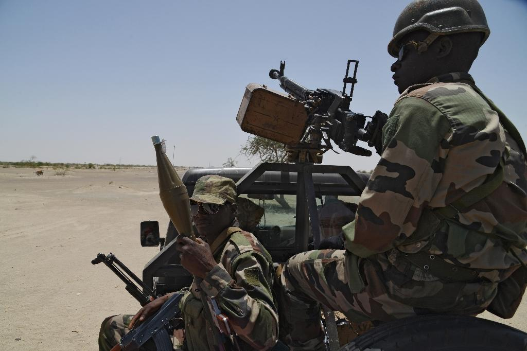 Soldiers patrol along Niger's border with Nigeria, near the south-eastern city of Bosso, on May 25, 2015