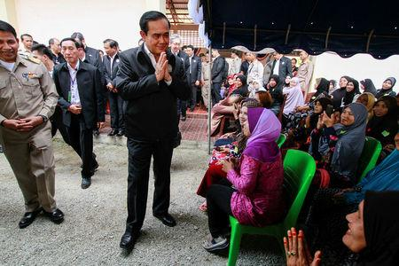 Thai Prime Minister Prayuth Chan-ocha gestures in traditional greeting during a visit at Ra-ngae district in the troubled southern province of Narathiwat, Thailand, January 6, 2017. REUTERS/Surapan Boonthanom