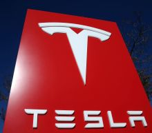 Tesla slashes prices to boost demand