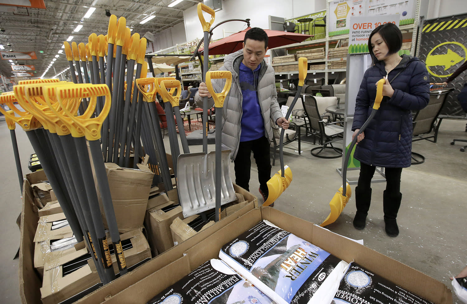 <p>Wei Chun Lin, left, and his wife Mei Chen, right, both of Quincy, Mass., examine snow shovels, Monday, March 13, 2017, at a hardware store, in Quincy. Weather forecasters say a nor'easter moving toward Massachusetts could bring about two feet of snow and high winds to central parts of the state Tuesday. (Steven Senne/AP) </p>