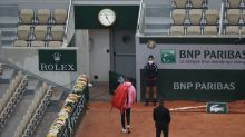 Victoria Azarenka refuses to play on after three games at chilly Roland Garros