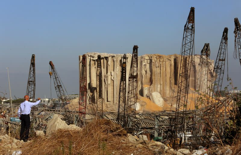 A man stands near the damaged grain silos following Tuesday's blast at Beirut's port area