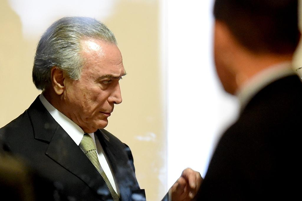 Michel Temer (L) was appointed interim President of Brazil after the suspension of Dilma Rousseff pending her impeachment trial
