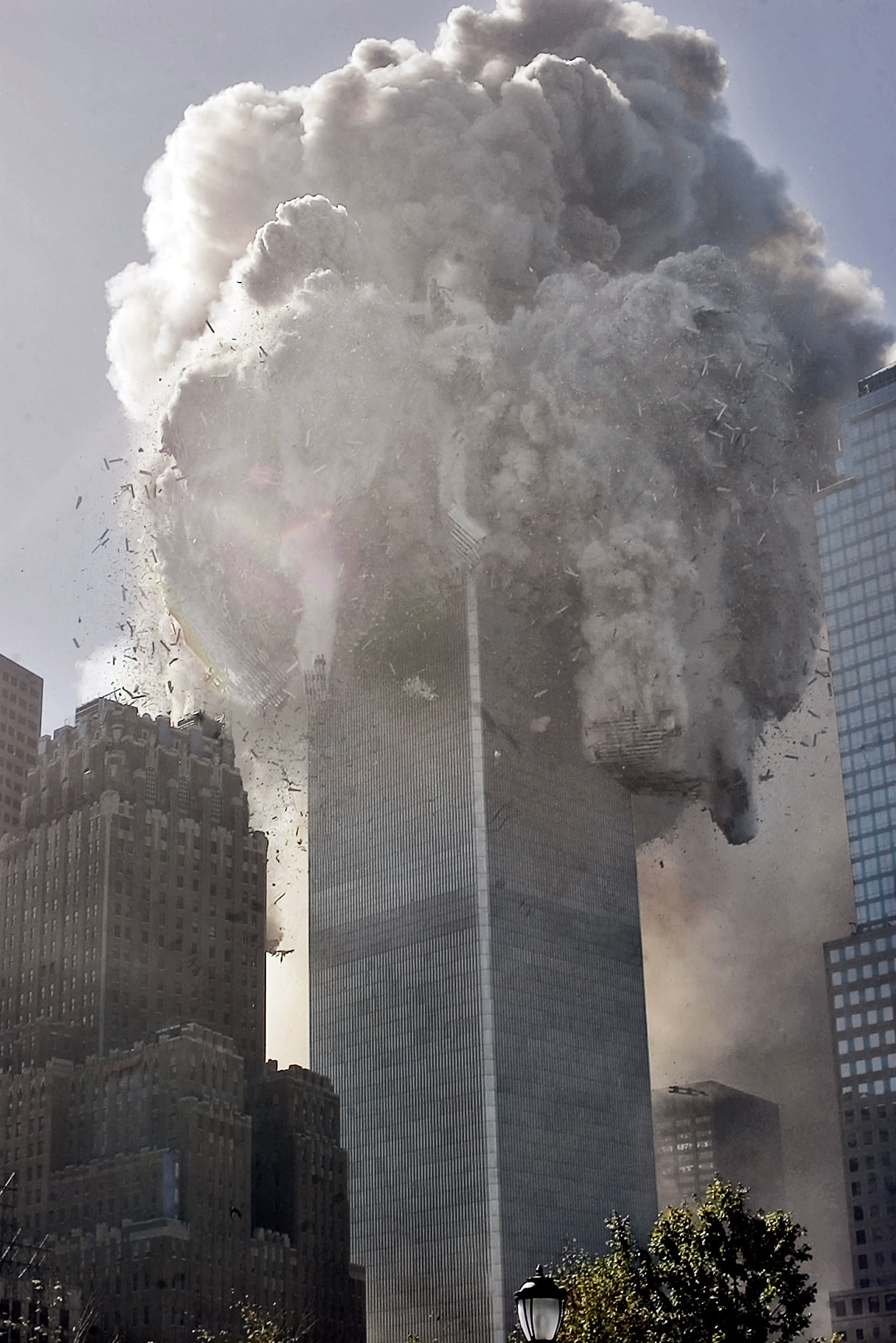 The north tower of New York's World Trade Center collapses after being struck by hijacked American Airlines Flt. 11, Tuesday, Sept. 11, 2001. (AP Photo Richard Drew)