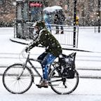 Britain hit by freezing temperatures as snow falls across the country