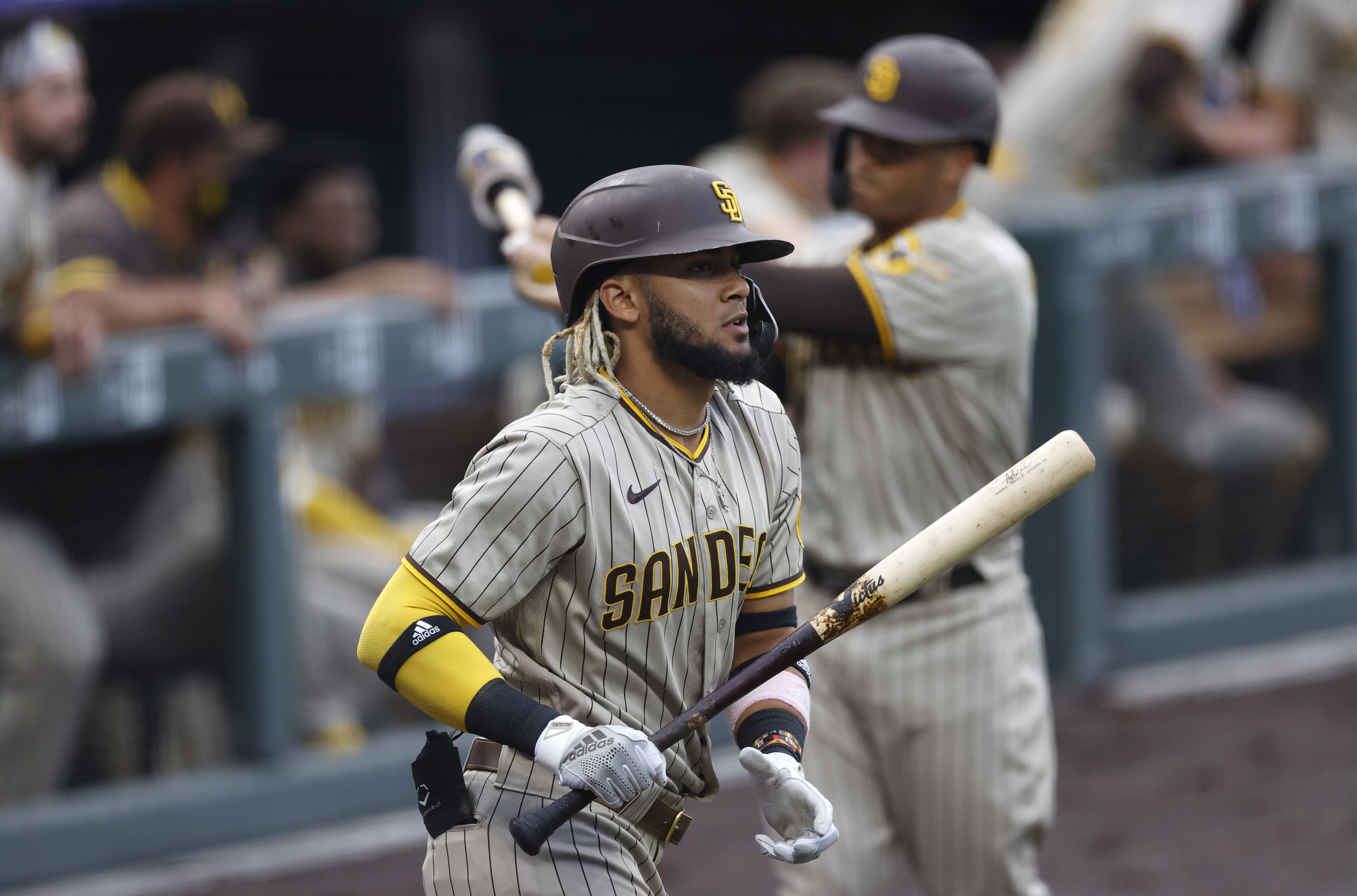 San Diego Padres' Fernando Tatis Jr. heads to the plate to lead off the first inning of a baseball game against the Colorado Rockies Friday, July 31, 2020, in Denver. (AP Photo/David Zalubowski)