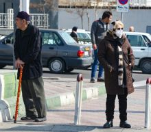 Iran neighbours impose travel bans as coronavirus toll rises
