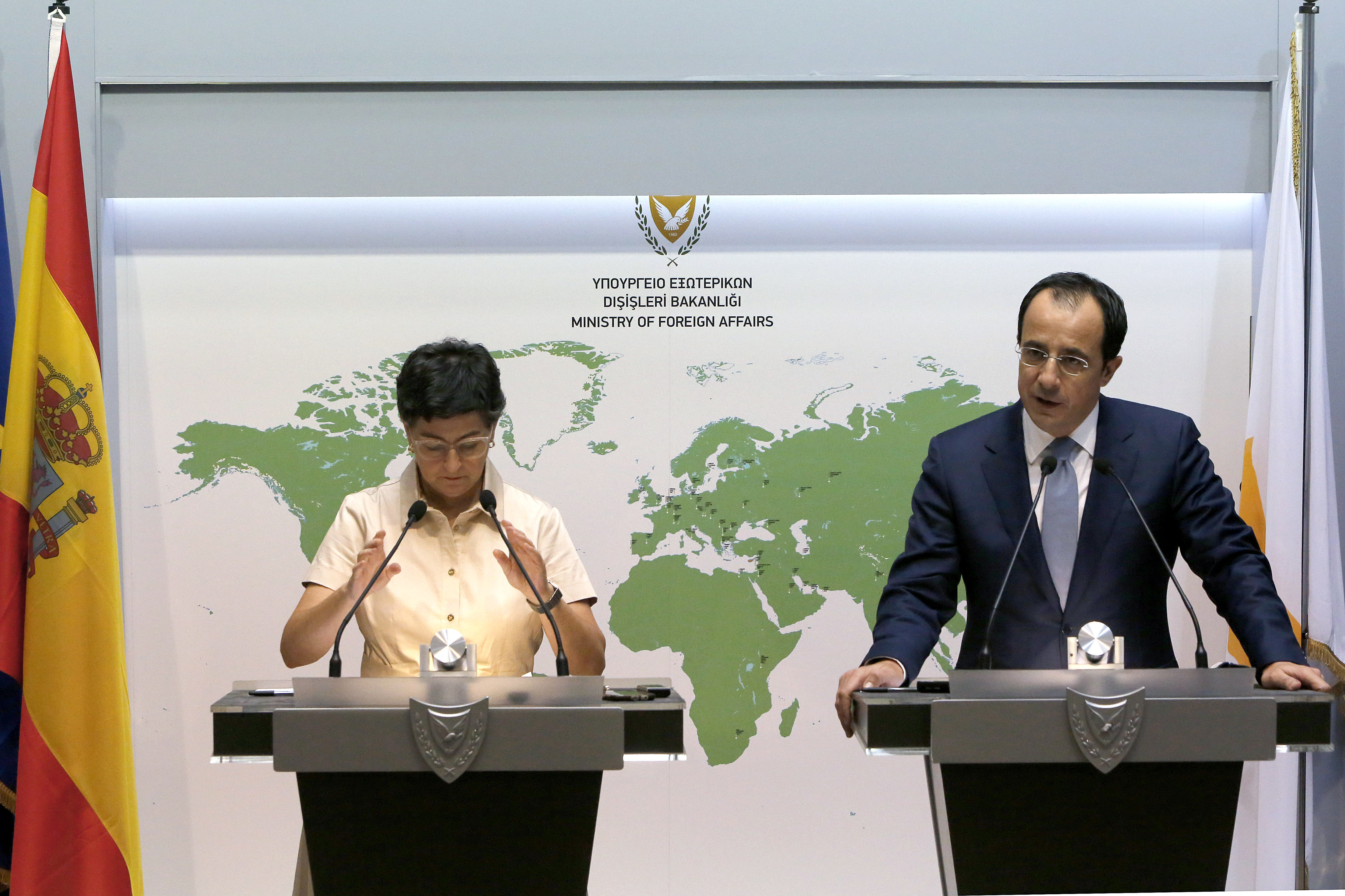 Spain's Foreign Minister Arancha Gonzalez Laya, left, talks during a news conference with her Cypriot countepart Nikos Christodoulides at the Cypriot Foreign Ministry building in the capital Nicosia, Cyprus, on Wednesday, Sept. 30, 2020. Laya said her visit aimed to convey her country's solidarity with Cyprus amid tensions over a Turkish gas search in waters were Cyprus claims exclusive economic rights. (AP Photo/Petros Karadjias)
