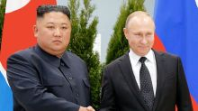 Vladimir Putin lends support to Kim Jong-un for ending nuclear standoff as pair meet for first summit