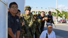Gunman, 2 workers killed in attack on Cancun prosecutor's office