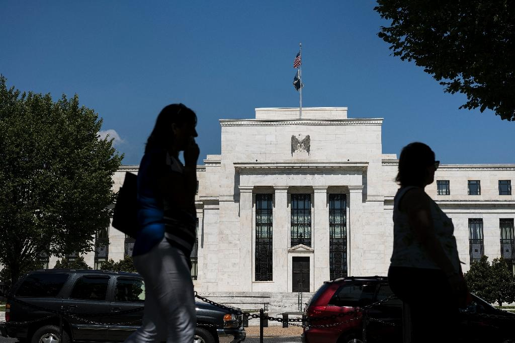 The Federal Reserve minutes recorded policymakers' deliberations at last month's meeting, when the central bank voted to raise interest rates by a quarter point to a range of one-to-1.25 percent -- a vote of confidence in the economy (AFP Photo/BRENDAN SMIALOWSKI)