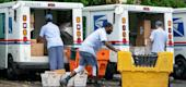 Letter carriers load mail trucks for deliveries at a U.S. Postal Service facility in McLean, Va. (AP)