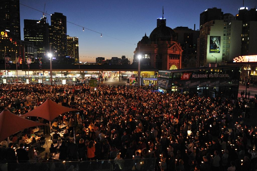People attend a candlelight vigil in support of asylum seekers, in Melbourne, in 2014 (AFP Photo/Esther Lim)