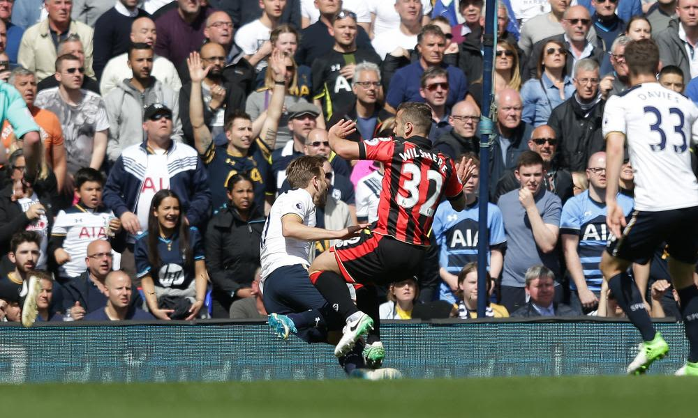 Bournemouth's Jack Wilshere is injured in a tackle with Harry Kane of Tottenham.