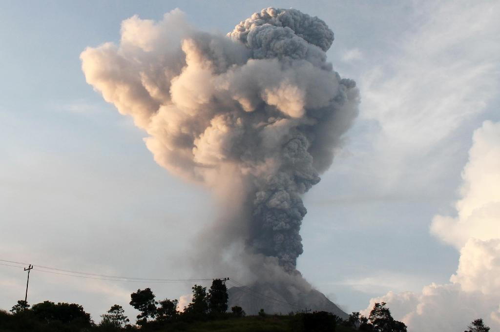 Volcanic ash spews from Mount Sinabung, a highly-active volcano on Sumatra island, on February 27, 2016